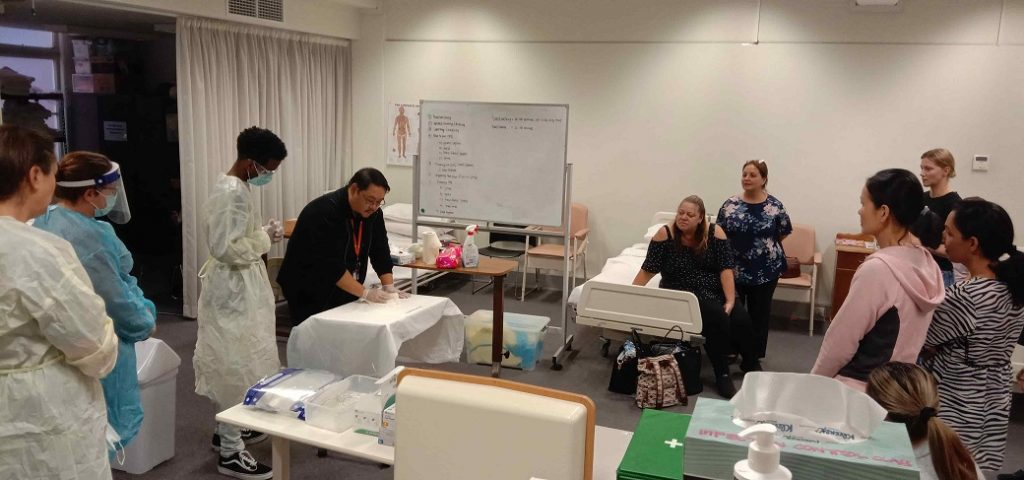 Doc Francos Teaches Students about Infection Control